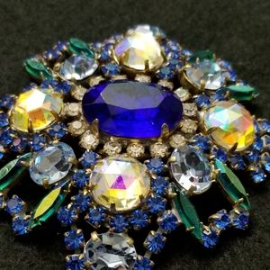 Vintage iridescent crystal pin or brooch in blues